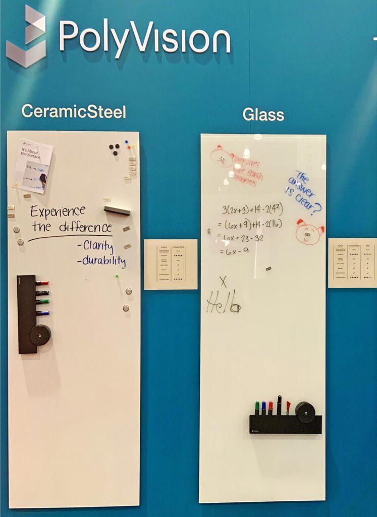 CeramicSteel白板与玻璃板并排悬挂在墙壁上,两者均有手写笔记和配件架